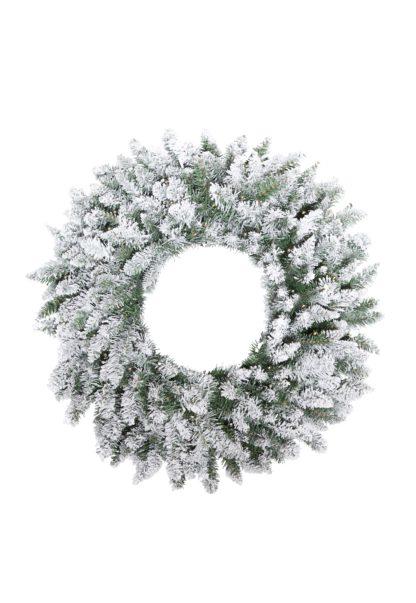 Besneeuwde kerstkrans met lichtjes